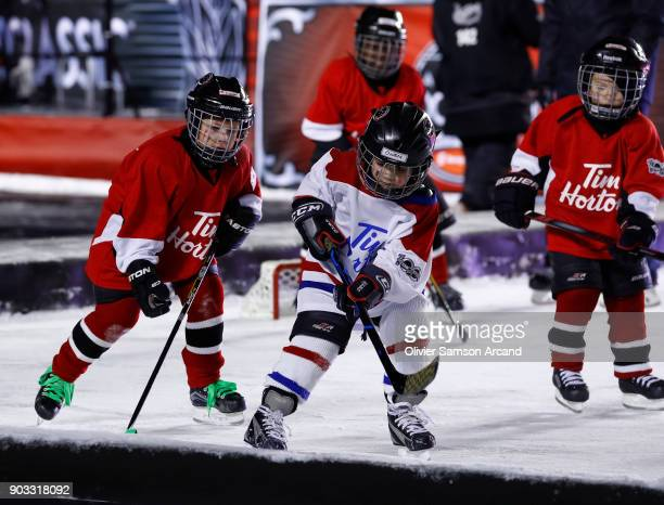 Tim Hortons TimBits hockey players play a game of hockey on the auxiliary rink during the first intermission of the 2017 Scotiabank NHL 100 Classic...