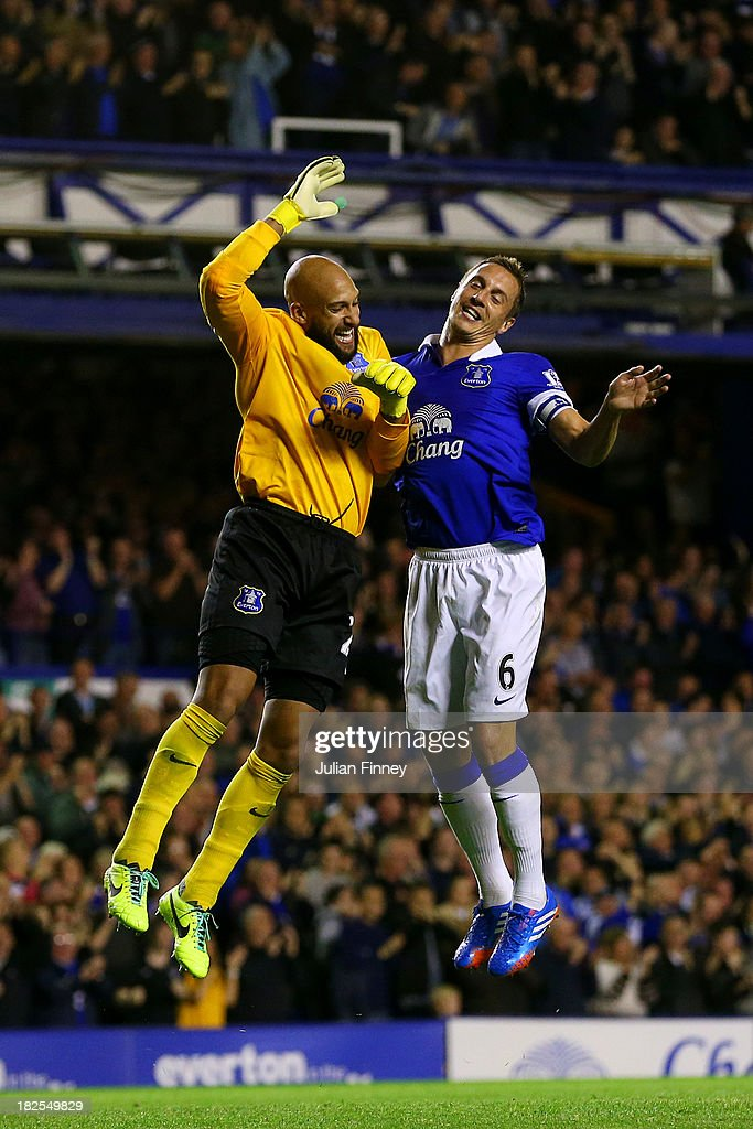 Tim Howard (L) and Phil Jagielka of Everton celebrate a goal during the Barclays Premier League match between Everton and Newcastle United at Goodison Park on September 30, 2013 in Liverpool, England.
