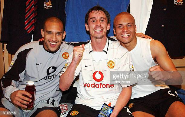 Tim Howard Gary Neville and Wes Brown celebrate in the dressing room after winning the AXA FA Cup match between Manchester United and Arsenal at...