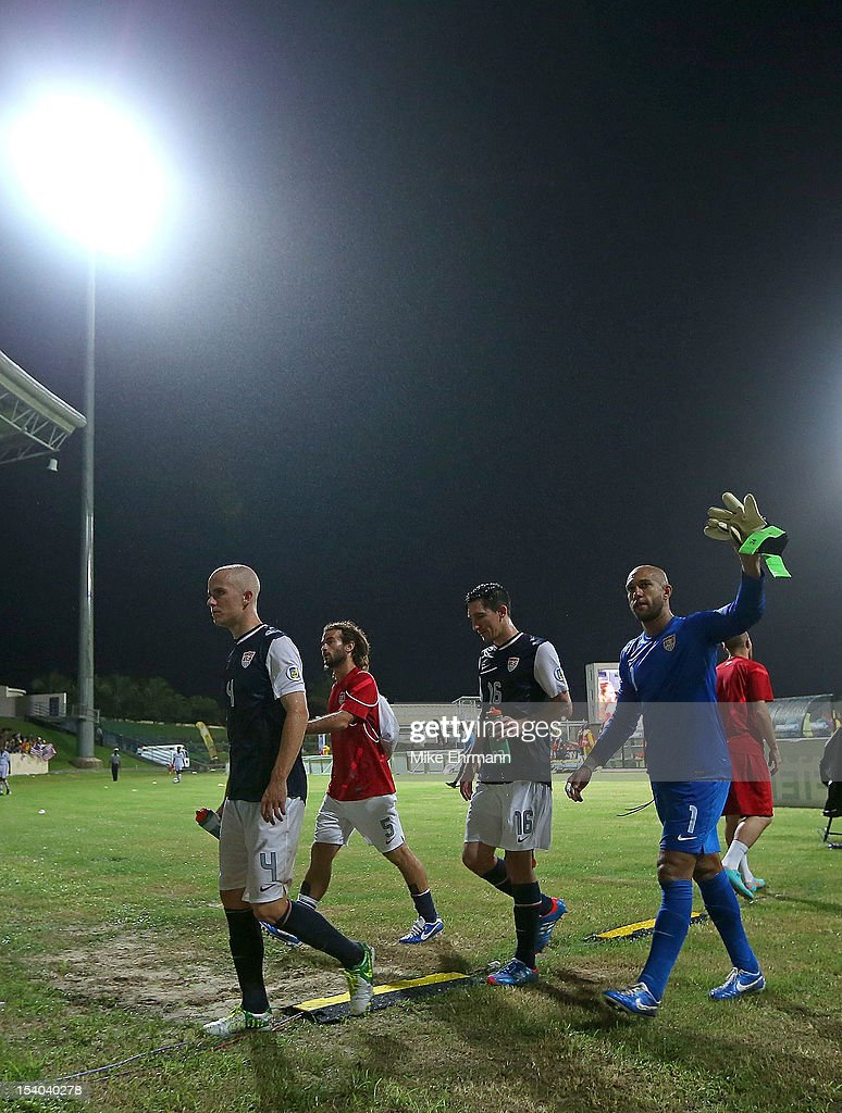 Tim Howard #1, Michael Bradley #4, and Sacha Kljestan #16 of the United States walk off the field after a World Cup Qualifying game against Antigua and Barbuda at Sir Vivian Richards Stadium on October 12, 2012 in Antigua, Antigua and Barbuda.