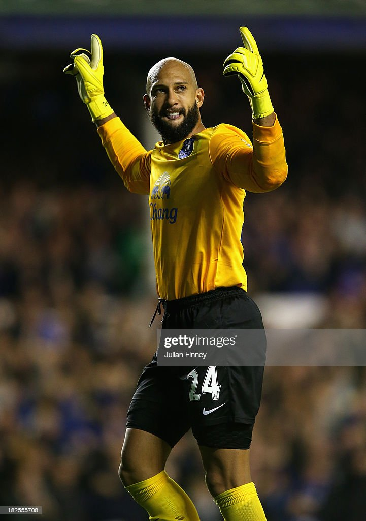 Tim Howard of Everton celebrates his assist for Everton's third goal during the Barclays Premier League match between Everton and Newcastle United at Goodison Park on September 30, 2013 in Liverpool, England.