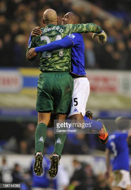 Tim Howard of Everton celebrates with Sylvain Distin at the end of the Barclays Premier League match between Everton and Chelsea at Goodison Park on...