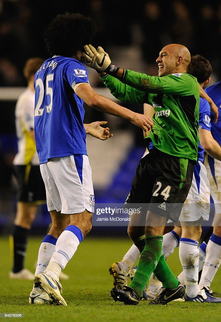 Tim Howard of Everton celebrates with team mate Marouane Fellaini at the end of the Barclays Premier League match between Everton and Tottenham Hotspur at Goodison Park on December 6, 2009 in Liverpool, England.