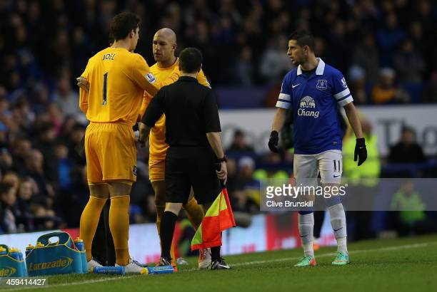 Tim Howard of Everton is substituted by team mate Joel Robles safter being shown the red card during the Barclays Premier League match between...
