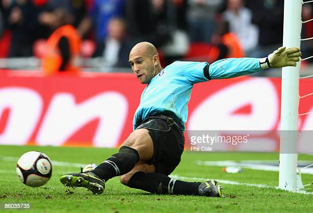 Tim Howard of Everton saves a penalty from Dimitar Berbatov of Manchester United in the shoot out during the FA Cup sponsored by EON Semi Final match...