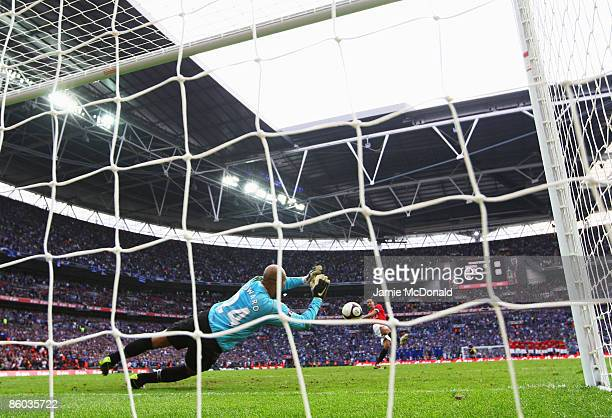 Tim Howard of Everton saves a penalty from Rio Ferdinand of Manchester United in the shoot out during the FA Cup sponsored by EON Semi Final match...