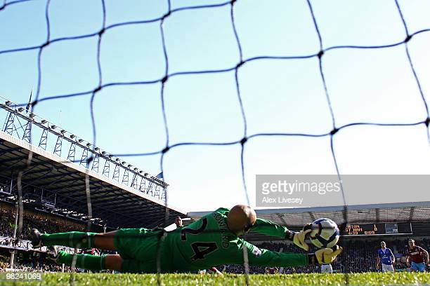 Tim Howard of Everton saves the penalty kick of Mido of West Ham United during the Barclays Premier League match between Everton and West Ham United...