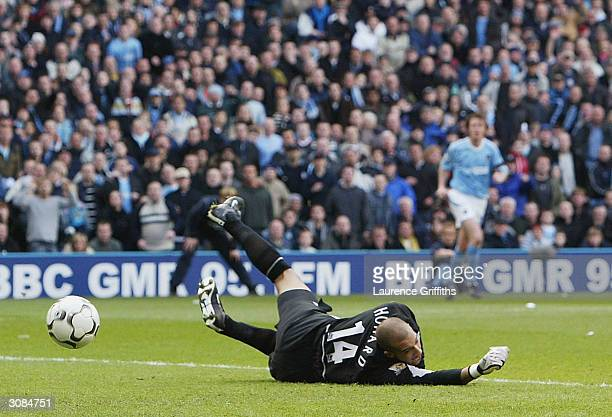 Tim Howard of Man Utd fails to stop a shot by Jon Macken of Man City during the FA Barclaycard Premiership match between Manchester City and...