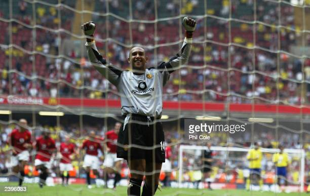 Tim Howard of Manchester United celebrates winning the Community Shield after he saves the final penalty from Robert Pires of Arsenal during the FA...