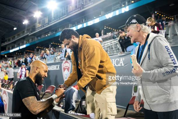 Tim Howard of the Colorado Rapids autographs a scarf for a fan at Dick's Sporting Goods Park on September 29 2019 in Commerce City Colorado