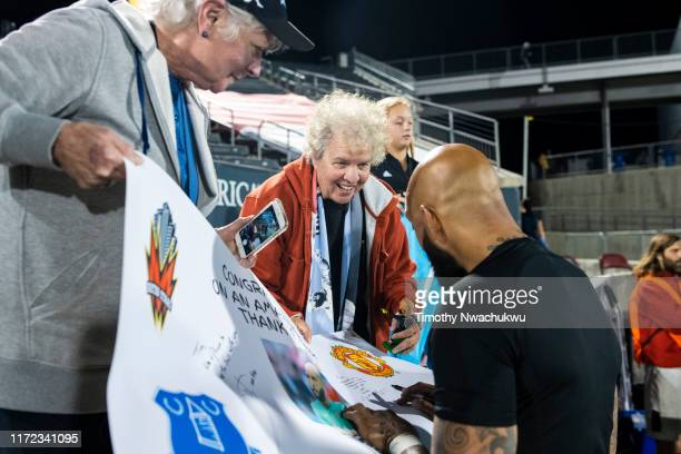Tim Howard of the Colorado Rapids autographs a sign for fans at Dick's Sporting Goods Park on September 29 2019 in Commerce City Colorado