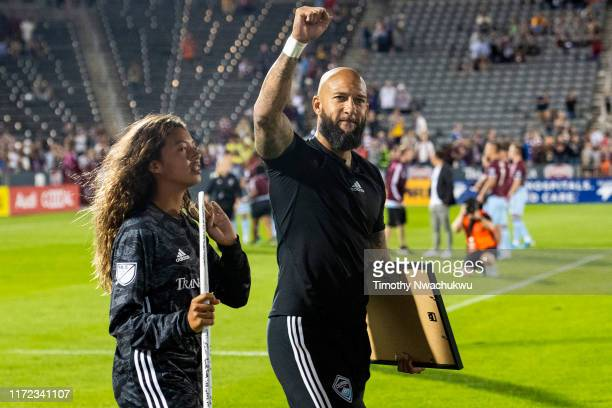 Tim Howard of the Colorado Rapids gestures towards fans with daughter Alivia at Dick's Sporting Goods Park on September 29 2019 in Commerce City...