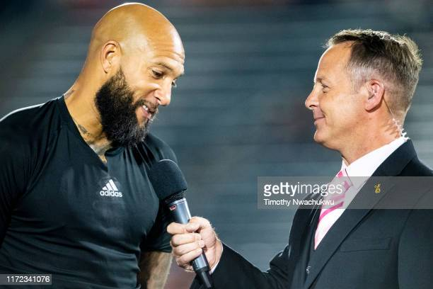 Tim Howard of the Colorado Rapids is interviewed by Richard Fleming during a commemorative retirement celebration at Dick's Sporting Goods Park on...