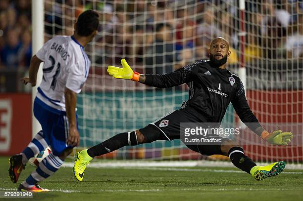 Tim Howard of the Colorado Rapids makes an unlikely save against a direct shot by Michael Barrios of FC Dallas in the second half of a game at Dick's...