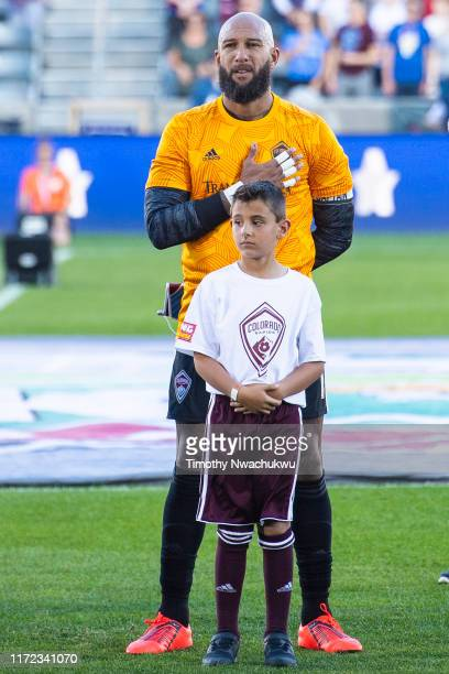 Tim Howard of the Colorado Rapids stands at attention with a fan prior to taking on FC Dallas at Dick's Sporting Goods Park on September 29 2019 in...