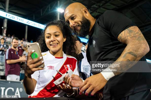 Tim Howard of the Colorado Rapids takes a photo with a fan at Dick's Sporting Goods Park on September 29 2019 in Commerce City Colorado