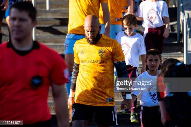 Tim Howard of the Colorado Rapids takes to the field with a fan prior to taking on FC Dallas at Dick's Sporting Goods Park on September 29 2019 in...