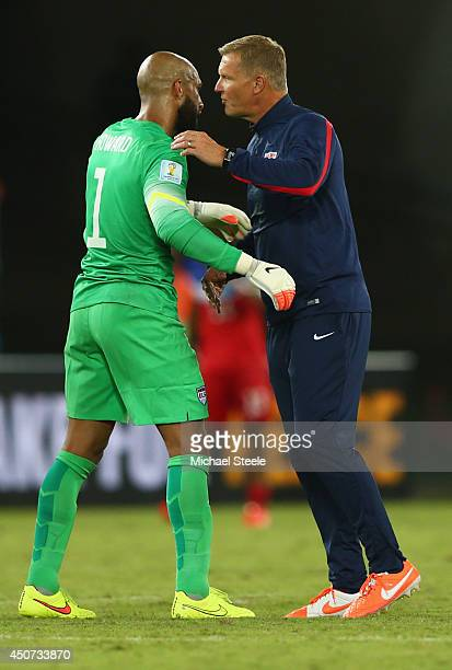 Tim Howard of the United States and goalkeeping coach Chris Woods celebrate victory after the 2014 FIFA World Cup Brazil Group G match between Ghana...
