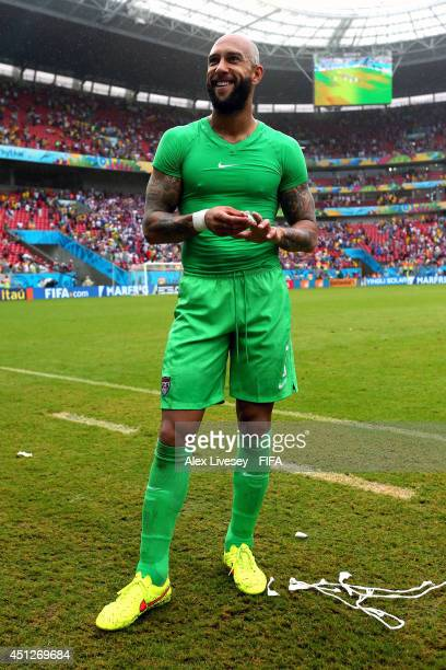 Tim Howard of the United States celebrates qualifying for the knock out stage dspite the 01 defeat after the 2014 FIFA World Cup Brazil Group G match...
