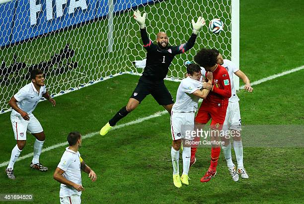 Tim Howard of the United States defends against Belgium during the 2014 FIFA World Cup Brazil Round of 16 match between Belgium and the United States...