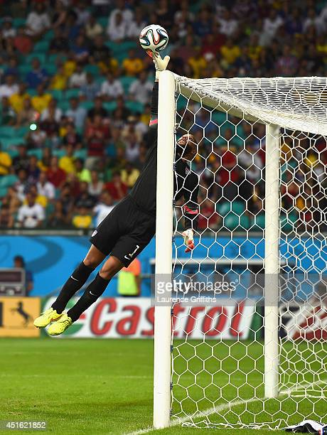 Tim Howard of the United States makes a fingertip save during the 2014 FIFA World Cup Brazil Round of 16 match between Belgium and the United States...