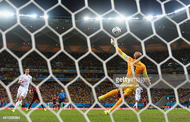 Tim Howard of the United States makes a save on a shot by Eder of Portugal during the 2014 FIFA World Cup Brazil Group G match between the United...