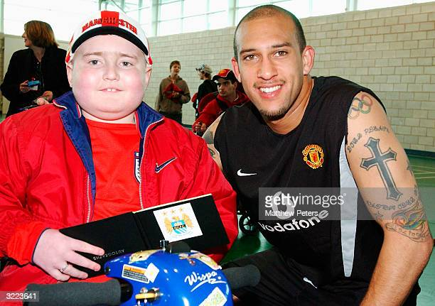 Tim Howard poses with Jack Kelly from Stretford during a Meet and Greet with disabled and terminally ill children at Carrington Training Ground,...