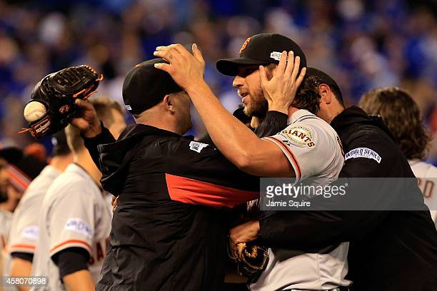 Tim Hudson celebrates with Madison Bumgarner of the San Francisco Giants on the field after defeating the Kansas City Royals 32 to win Game Seven of...