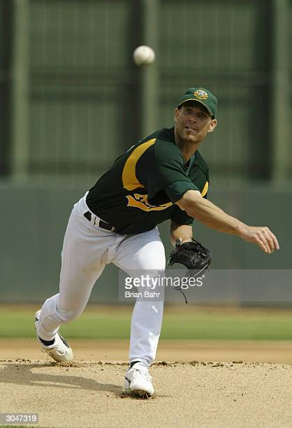 Tim Hudson of the Oakland A's warms up for a game against the Milwaukee Brewers on March 5 2004 at Phoenix Municipal Stadium in Phoenix Arizona The...