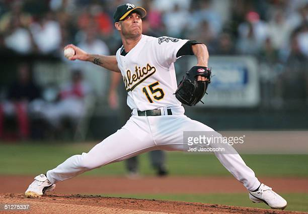 Tim Hudson of the Oakland Athletics delivers a pitch against the Boston Red Sox during a MLB game at the Network Associates Coliseum on September 7...