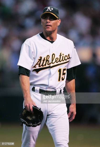 Tim Hudson of the Oakland Athletics walks off the mound after the first inning against the Boston Red Sox during a MLB game at the Network Associates...