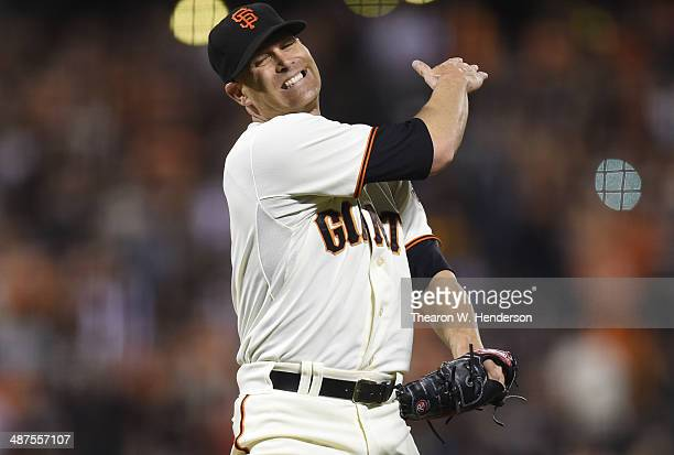 Tim Hudson of the San Francisco Giants reacts after Yasmani Grandal of the San Diego Padres hit a solo home run in the top of the ninth inning at...