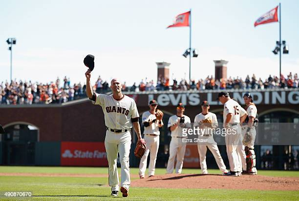 Tim Hudson of the San Francisco Giants waves to the crowd after being taken out of the game in the third inning of their game against the Los Angeles...