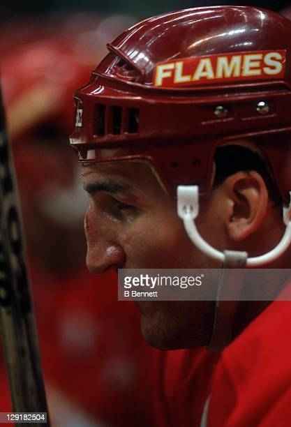 Tim Hunter of the Calgary Flames looks on from the bench during an NHL game circa 1987