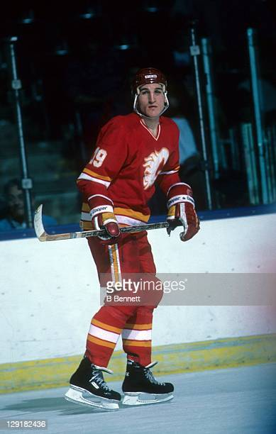Tim Hunter of the Calgary Flames skates on the ice during an NHL game against the New York Islanders on February 19, 1985 at the Nassau Coliseum in...