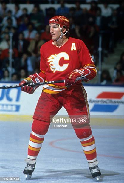 Tim Hunter of the Calgary Flames skates on the ice during an NHL game against the New York Islanders on March 27 1990 at the Nassau Coliseum in...