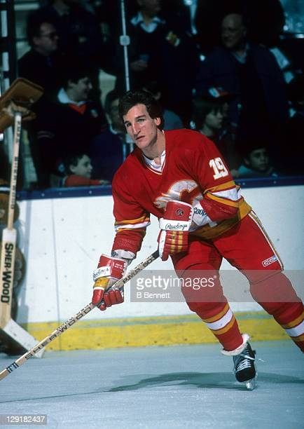 Tim Hunter of the Calgary Flames warms-up before an NHL game against the New York Islanders on February 19, 1985 at the Nassau Coliseum in Uniondale,...