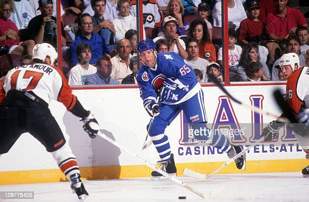 Tim Hunter of the Quebec Nordiques passes the puck against Rod Brind'Amour of the Philadelphia Flyers during their game on January 28, 1993 at the...