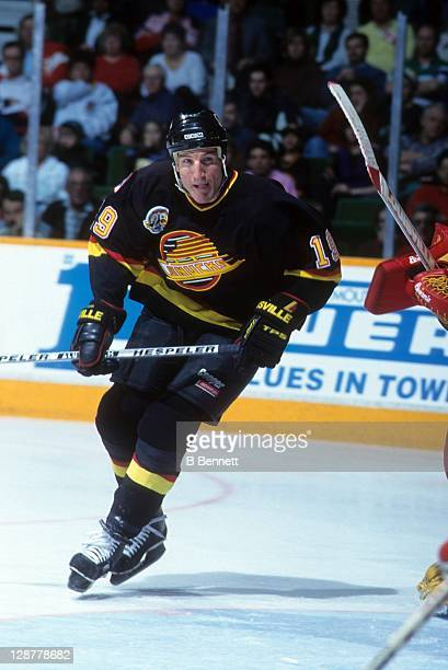Tim Hunter of the Vancouver Canucks skates on the ice during an NHL game in March 1995