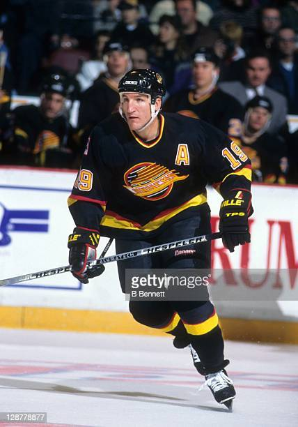 Tim Hunter of the Vancouver Canucks skates on the ice during an NHL game against the Philadelphia Flyers on November 19 1995 at the Spectrum in...