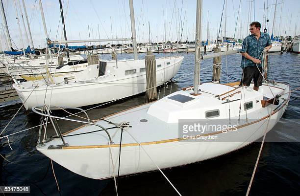 Tim Huth makes final adjustments as he secures his sailboat before evacuating ahead of Hurricane Katrina August 28 2005 in New Orleans Louisiana The...