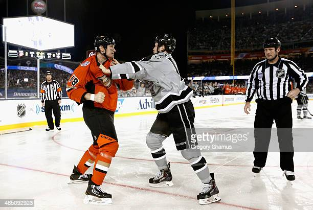 Tim Jackman of the Anaheim Ducks tangles with Kyle Clifford of the Los Angeles Kings during a second period fight during the 2014 Coors Light NHL...