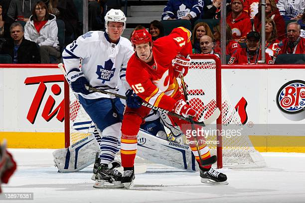 Tim Jackman of the Calgary Flames skates against Jake Gardiner of the Toronto Maple Leafs on February 14 2012 at the Scotiabank Saddledome in Calgary...