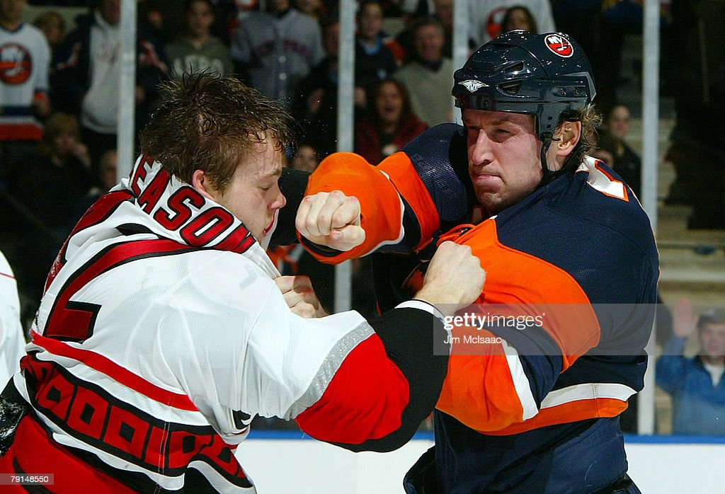 Tim Jackman #28 of the New York Islanders throws a punch at Tim Gleason #42 of the Carolina Hurricanes fight during their second period on January 21, 2008 at Nassau Coliseum in Uniondale, New York.