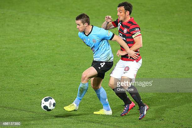 Tim Jackson of the Sharks and Mark Bridge of the Wanderers compete for the ball during the FFA Cup Round of 16 match between Palm Beach Sharks and...