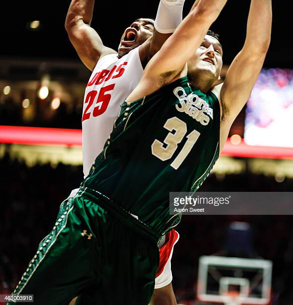 Tim Jacobs of the New Mexico Lobos fights for the rebound against JJ Avila of the Colorado State Rams during their game at The WisePies Arena on...