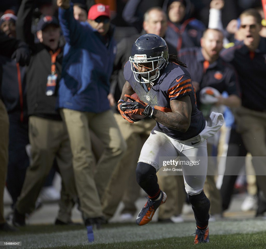 Tim Jennings #26 of the Chicago Bears heads down the field on his way to scoring a touchdown after pulling down an interception against the Carolina Panthers on October 28, 2012 at Soldier Field in Chicago, Illinois. The Bears defeated the Panther 23-22.