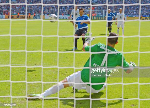 Tim Jerat of Bielefeld scores a penalty against goalkeeper Marjan Petkovic of Braunschweig during the DFB Cup first round match between Arminia...