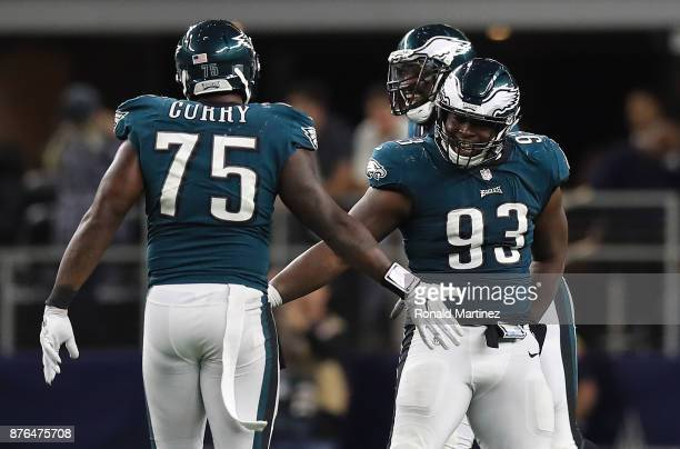 Tim Jernigan of the Philadelphia Eagles celebrates with Vinny Curry in the second half against the Dallas Cowboys at AT&T Stadium on November 19,...