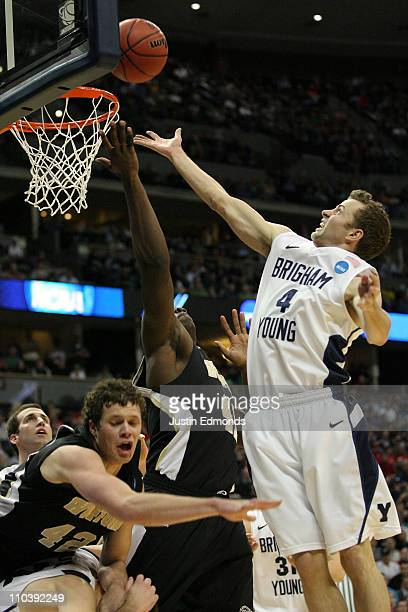 Tim Johnson of the Wofford Terriers and Jackson Emery of the Brigham Young Cougars fight for a rebound during the second round of the 2011 NCAA men's...